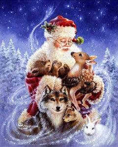 De kerstman met dieren in zijn armen 20x25